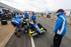kaylen frederick   pilot one racing   working on race car