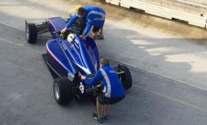 kaylen frederick   pilot one racing   team helping move car