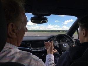 kaylen frederick | pilot one racing | trainer with kaylen in car