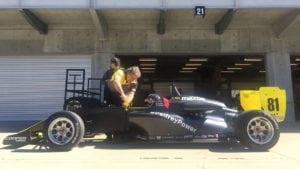 kaylen frederick | pilot one racing | team checking car