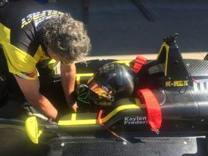 kaylen frederick | pilot one racing | team helping kaylen in car