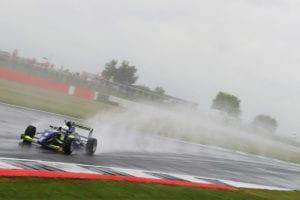 kaylen frederick   pilot one racing   race car on wet track mist
